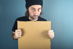 Man holding blank cardboard paper Stock Image