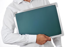 Man holding a blank chalkboard Stock Photos