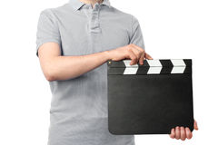 Man holding blank cinema clapper board isolated on white background Royalty Free Stock Image