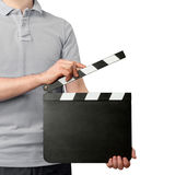 Man holding blank clapper board. Close-up of young man holding blank clapper board isolated on white background Stock Photography
