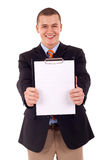 Man holding a blank clipboard Royalty Free Stock Photos