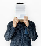 Man holding blank digital tablet cover face studio portrait stock photos