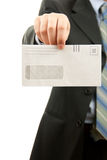 Man holding Blank envelop. Man in a suit is holding a blanck envelop Royalty Free Stock Photography