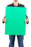 Man holding blank green board Royalty Free Stock Photography