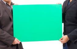 Man holding blank green board Royalty Free Stock Image