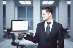 Man holding blank laptop Stock Photos
