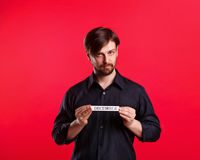 Man holding blank with name of month December Royalty Free Stock Photos