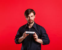 Man holding blank with name of month February Royalty Free Stock Images