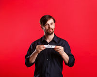 Man holding blank with name of month July Stock Image