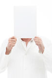 Man holding blank note over his head Royalty Free Stock Images
