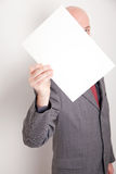 Man holding blank paper. Man wearing suit holding blank paper Royalty Free Stock Images