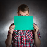 Man holding blank paper. Royalty Free Stock Photography