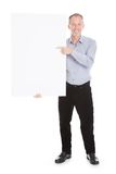 Man holding blank placard Royalty Free Stock Photo
