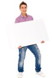 Man holding blank poster Royalty Free Stock Images