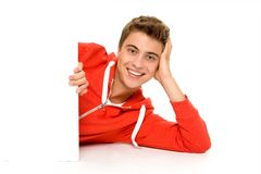 Man holding blank poster. Young man holding blank poster Royalty Free Stock Images