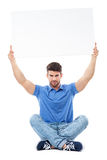 Man holding blank poster above his head Stock Image