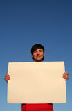 Man holding blank poster board Royalty Free Stock Photos
