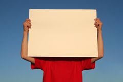 Man holding blank poster board Royalty Free Stock Images
