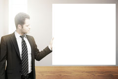 Man holding blank poster Royalty Free Stock Photography