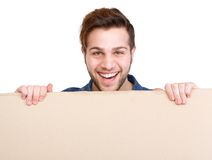 Man holding blank poster sign Stock Photo