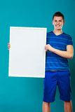 Man Holding Blank Presentation Board On Blue Stock Photos