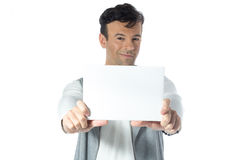 Man is holding a blank rectangular banner. Brazilian male wearin Royalty Free Stock Images