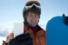 Man holding blank skipass smiling Royalty Free Stock Photos