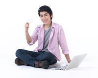 A man holding a blank white card Royalty Free Stock Image