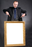 Man holding blank white card in frame Royalty Free Stock Photography