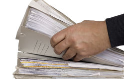 Man is holding block of finance documents. Man hand and block of documents on white background Royalty Free Stock Image