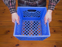 Man Holding Blue Crate Stock Image