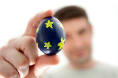 Man Holding a Blue Easter Egg Stock Photo