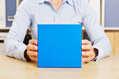 Man holding blue gift in his hands Stock Images