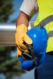 Man holding blue helmet Stock Image