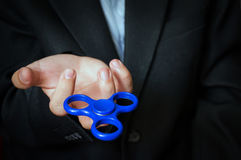 A man holding a blue spinner. Royalty Free Stock Photography