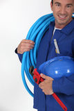 Man holding blue tube Royalty Free Stock Photography