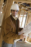 Man Holding Blueprint In Construction Site Stock Images