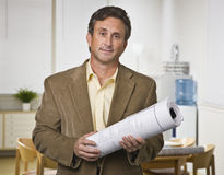 Man Holding Blueprints Royalty Free Stock Photography