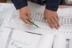 Man holding blueprints at construction site Stock Photography