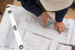 Man holding blueprints at construction site Royalty Free Stock Photography