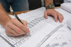 Man holding blueprints at construction site Royalty Free Stock Image