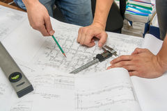 Man holding blueprints at construction site Royalty Free Stock Images