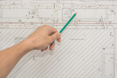 Man holding blueprints at construction site Stock Images