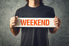 Man holding board with WEEKEND title Stock Photography