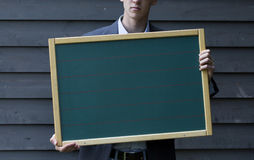 Man holding a board Royalty Free Stock Image