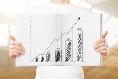 Man holding book with business chart Royalty Free Stock Image