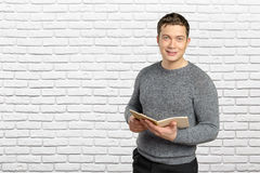 Man holding book. Handsome young man holding book Stock Images