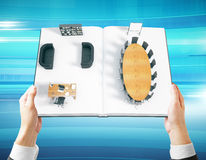 Man holding book with interior Stock Photography