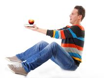 Man holding a book and one red apple full body Royalty Free Stock Image
