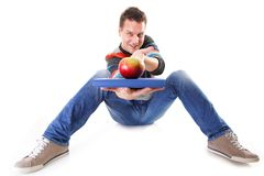 Man holding a book and one red apple full body Stock Images